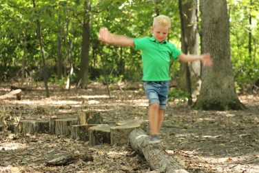 child playing at Nature Playscape at the W.W. Knight Nature Preserve