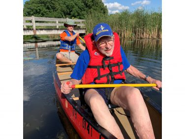 image of two people for an adaptive paddle experience with Kingston Rehabilitation